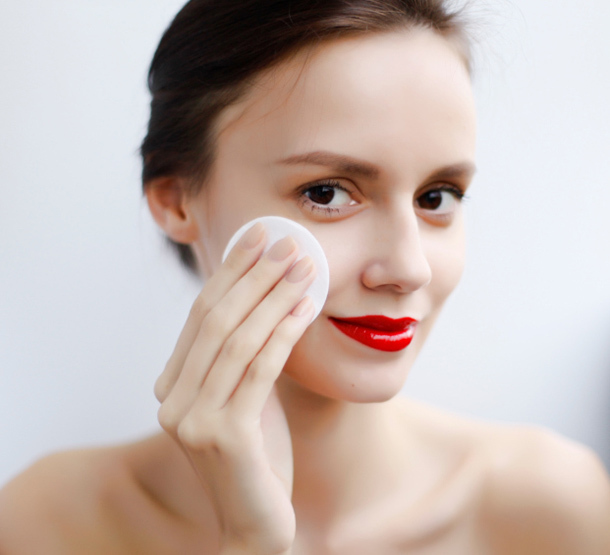 beautifull woman with red lips making make-up removing